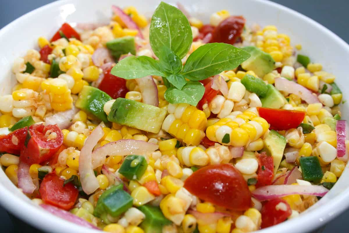 This summer corn salad is a hit wherever it goes and it is my go-to salad for any BBQs. It screams summer time! It is light, crisp and oh so tasty! The best part of this recipe is its ease and can be adapted to fit your taste or what's in your fridge.