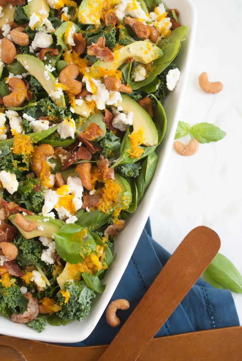 Orange Vinaigrette Salad - Baby spinach, kale and whole leaves of basil topped with avocado, bacon, feta honey roasted cashews and a TASTY Orange Vinaigrette! Such a perfect summer dish!