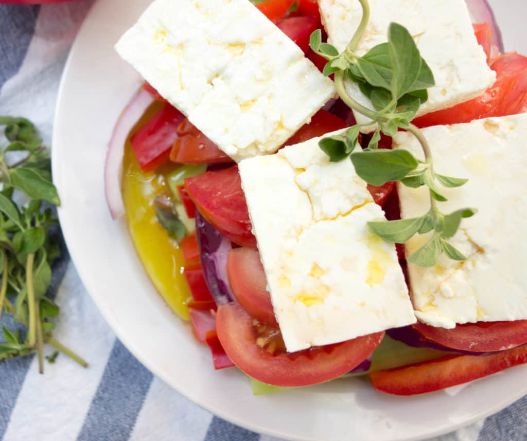 This fresh and easy Greek Horiatiki Salad is my absolute fave way to enjoy all those delicious late summer tomatoes, cucumbers, peppers and onions. Horiatki Greek Salad makes a delicious side dish or healthy entree with a hunk of crusty bread. Check it out at femalefoodie.com.