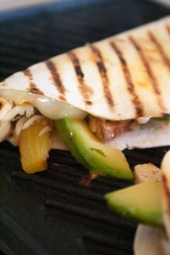 Grilled chicken and pineapple quesadillas! Loaded with sweet pineapple and barbeque sauce, and cheesey, spicy jalapeno slices inside a crisp, and buttery flour tortilla. Check out the full recipe at femalefoodie.com!