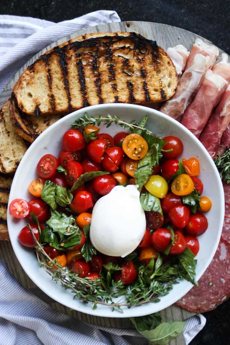 Marinated Tomatoes & Burrata with Grilled Sourdough Bread. This is my new favorite easy summer dinner! Simple, beautiful, and so delicious! Full recipe at femalefoodie.com!