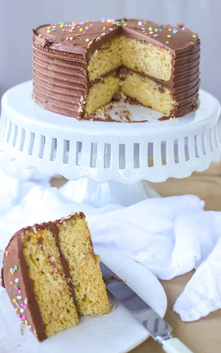 This recipe for moist yellow cake with chocolate buttercream frosting because is easy, beautiful, and an absolute crowd pleaser. Full recipe at femalefoodie.com!