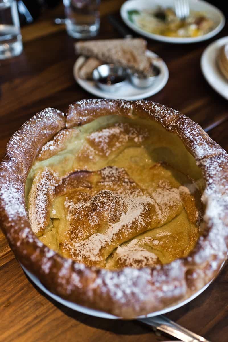 Top 8 spots for the best breakfast & brunch in Orange County. Plum's Cafe in Costa Mesa serves delicious breakfast and brunch dishes with Pacific Northwest flair, like their Famous Dutch Baby. Full post at femalefoodie.com.