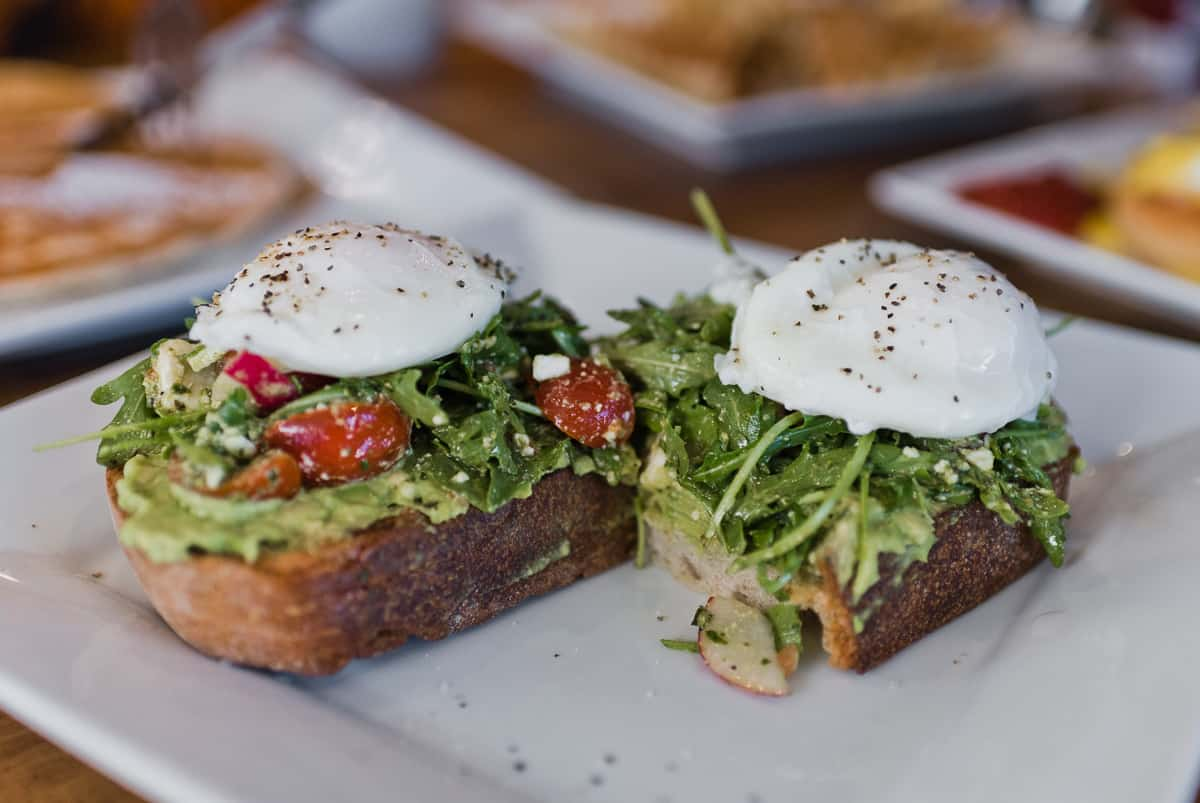Top 8 spots for the best breakfast & brunch in Orange County. Crema Cafe and Artisan Bakery in Seal Beach serves delicious breakfast and brunch dishes with European inspired flair. Full post at femalefoodie.com.
