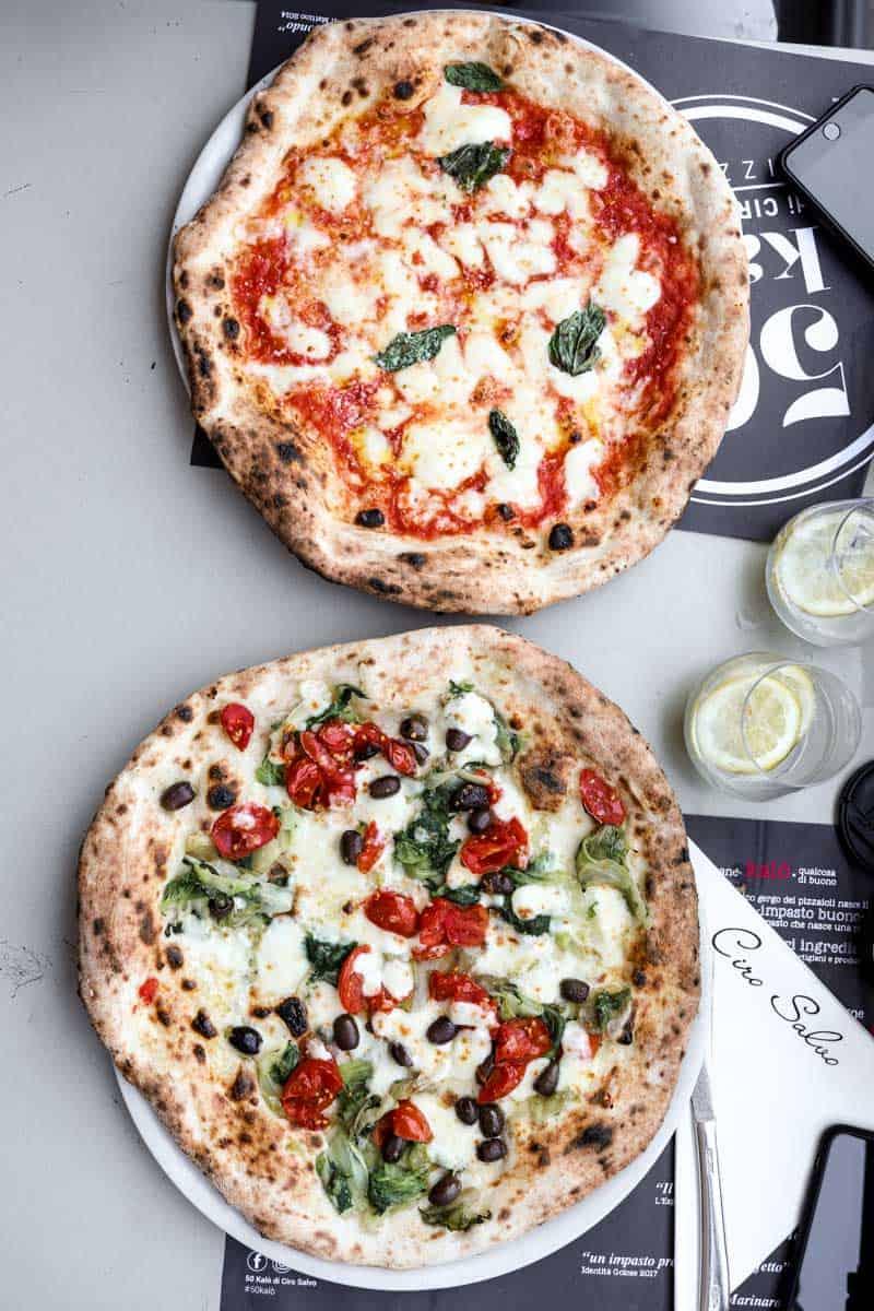 Two Neapolitan pizzas at 50 Kalo restaurant in Naples, Italy