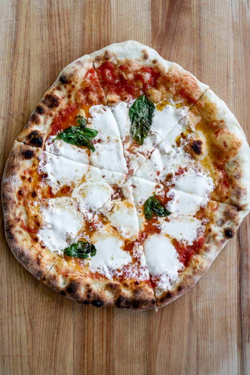 margherita pizza on cutting board