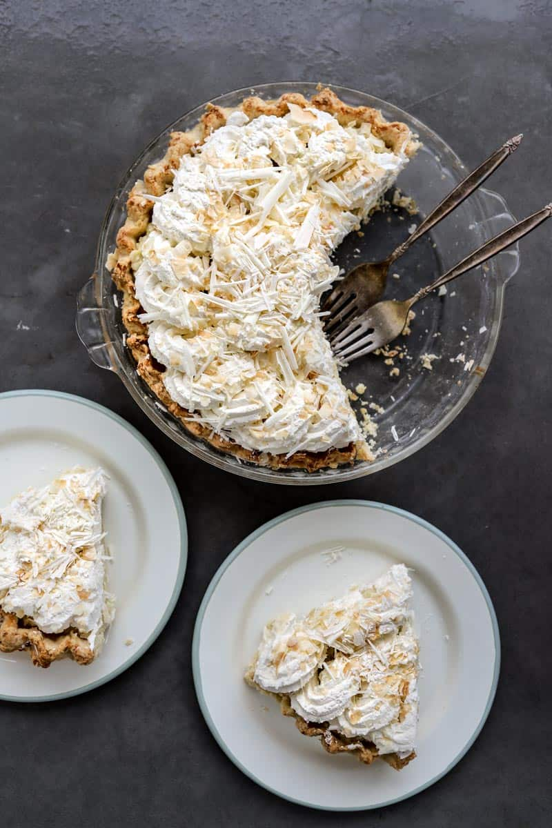 Tom Douglas triple coconut cream pie, cut in two pieces