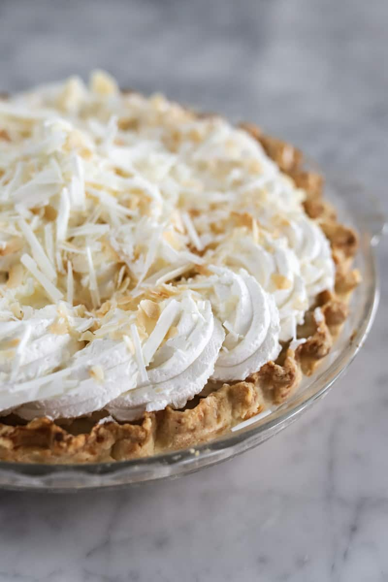 close up view of triple coconut cream pie