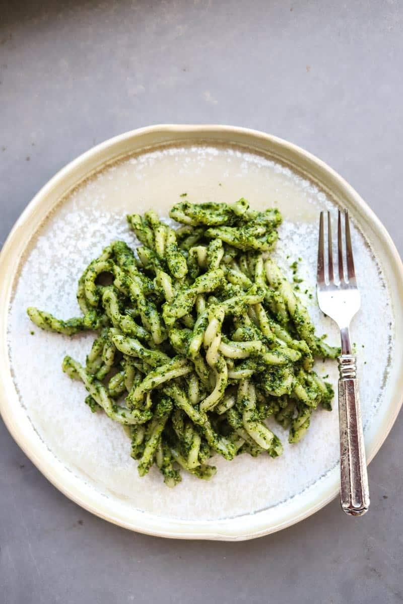 homemade pasta with pesto on plate