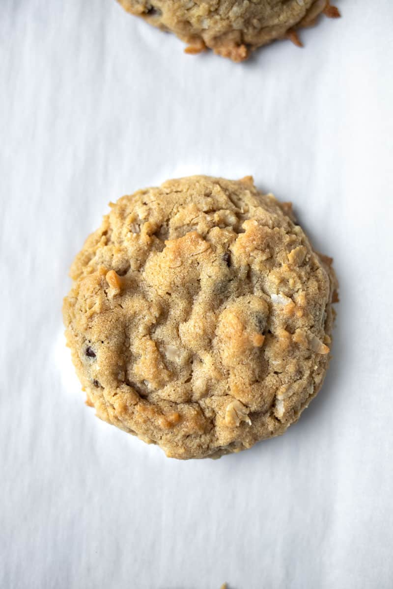 peanut butter oatmeal chocolate chip cookie on parchment paper