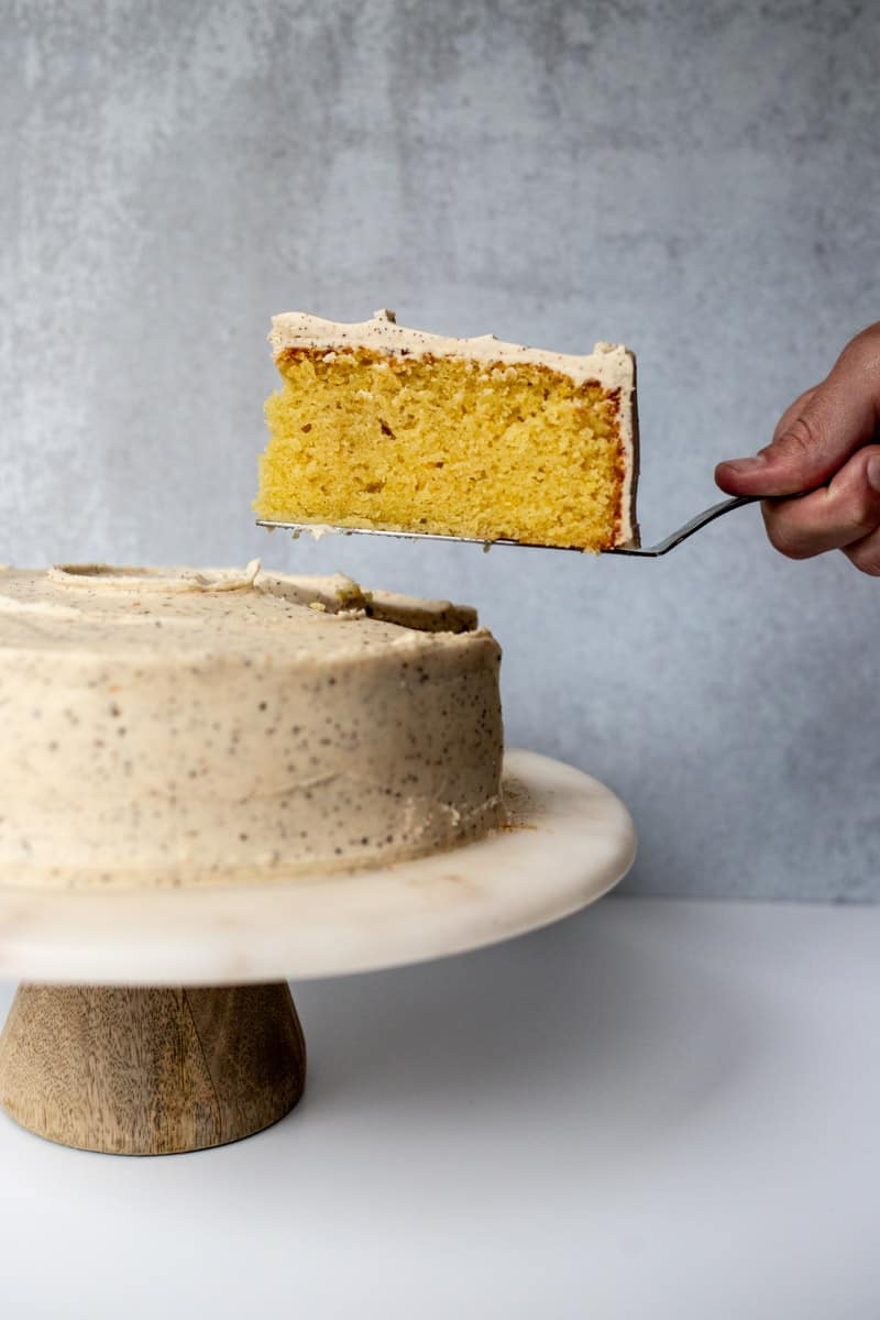 one slice being removed from cake